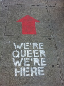 "An altered version of the phrase: ""We're Here, We're Queer, Get Used To It"""